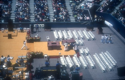 "Dance troupe building the altar in Arthur Ashe Stadium from ""stones in the field"" (large blocks of brownstone)"