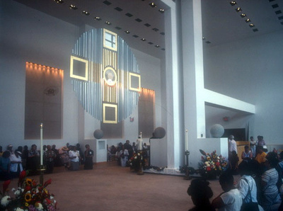 Renovata Studios, Inc. Giant monstrance suspended from trusswork in the Arthur Ashe Stadium player's lounge for Brooklyn/Queens Millenium Mass.
